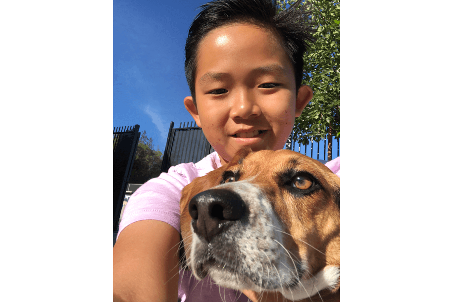 child taking selfie with dog