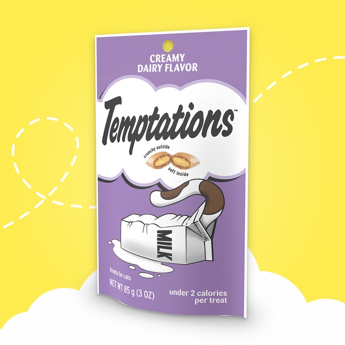 purple bag of temptations creamy dairy flavored treats on yellow background
