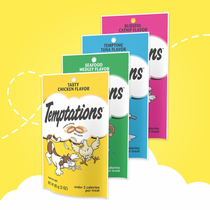 six bags of different temptations feline favorite treats on yellow background