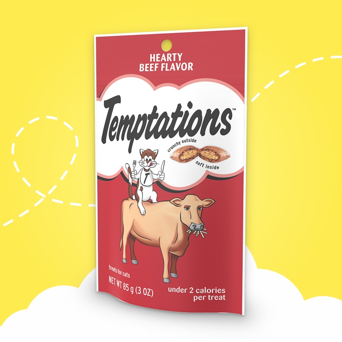 red bag of temptations heart beef flavored treats on yellow background