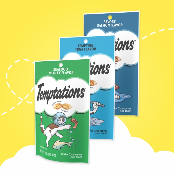 three bags of different temptations feline favorite treats on yellow background