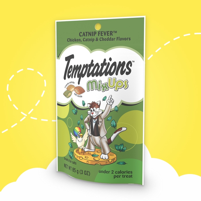 dark green bag of temptations mixups catnip fever flavored treats  on yellow background