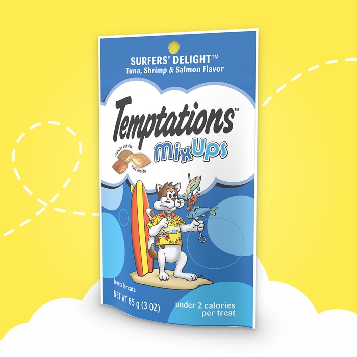 dark blue bag of temptations mixups surfers delight flavored treats on yellow background