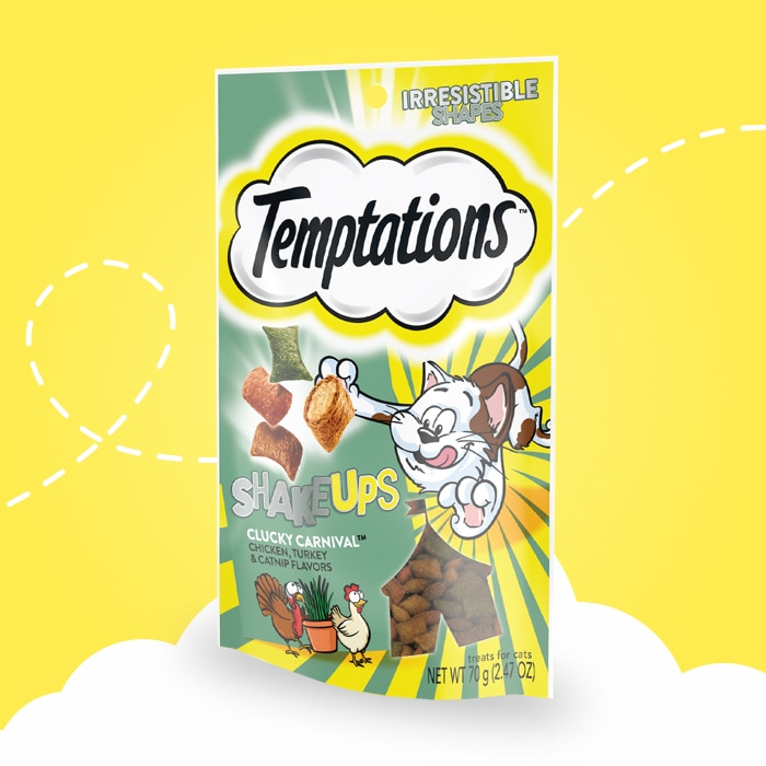 Temptations™ Shakeups clucky carnival cat treats front package yellow backdrop